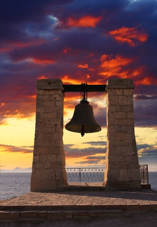Dramatic view on famous bell in Khersones, Sevastopol, Ukraine photo
