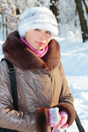 Winter portrait of a pretty girl outdoors photo