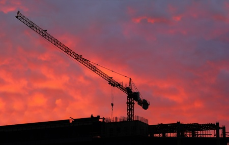 Tall building under construction over beautiful sunset sky  photo