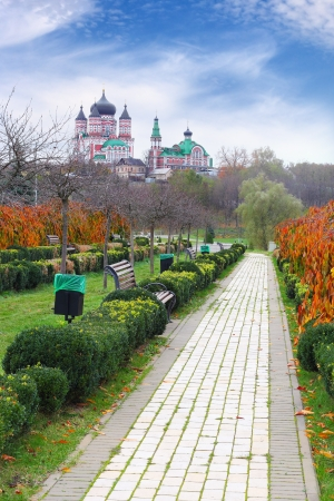 Park Feofania in Autumn over cloudy blue sky, Kiev, Ukraine photo