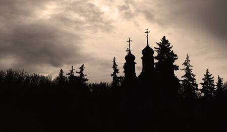desecrated: Evil black and white view on the church in the forest Stock Photo