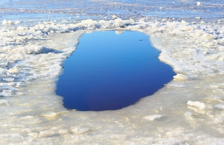 Blue ice hole for winter bathing in January photo