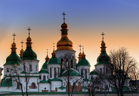 kyiv: Domes of Saint Sophia Cathedral in Kiev over dramatic sunset sky Stock Photo