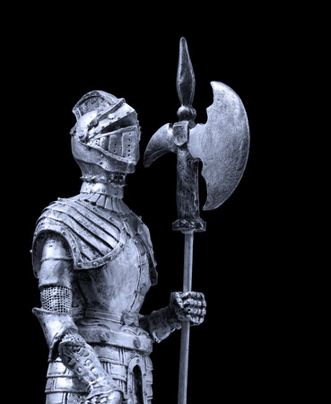 halberd: A knight dressed with full plate mail and armed with a halberd Stock Photo