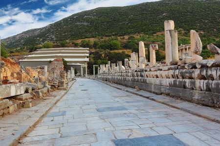 Stone passage in Ephesus with pillars along the way, Turkey photo