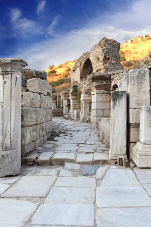 Stone passage in Ephesus with pillars and arches along the way Stock Photo