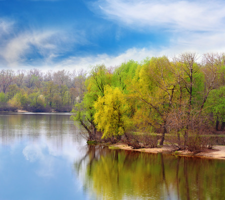 river scape: Beautiful autumnal river scape over dramatic blue sky Stock Photo