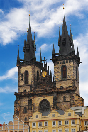 tyn: The Tyn Church in Prague over dramatic blue sky