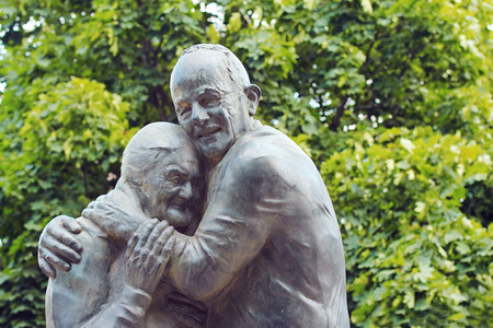 Kyiv, Ukraine - August 16, 2014: monument Italian prisoner of war Luigi Pedutto and consigned to forced labor Ukrainian Mokrin Yurzuk met in 1943 in the Austrian POW camp and who spent there two years. After tens of years of separation they finally met