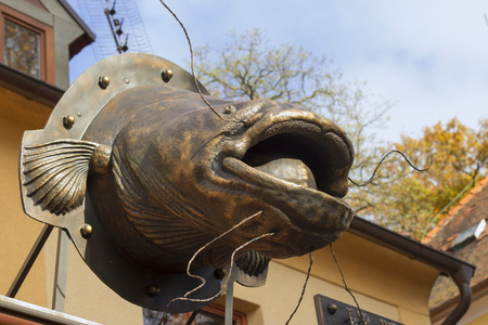 A decoration over the restaurant: a huge bronze cat-fish.