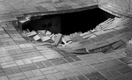 A hole in pedestrian pavement road Stock Photo