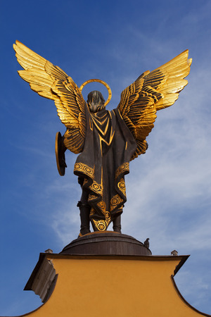 archangel: Golden statue of Archangel Michael at the Independence Square in Kiev, Ukraine