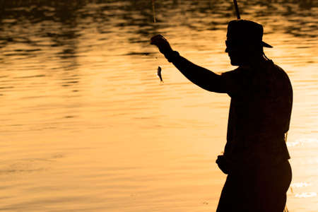 caught: A fisherman caught a small fish