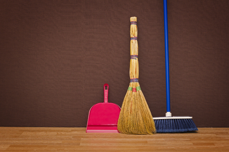 brooms: Cleaning up the apartment: brooms and a dustpan Stock Photo