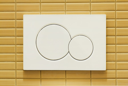 flushing: Modern plastic flushing buttons with ability to save water Stock Photo