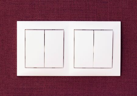 switches: A pair of white plastic button switches