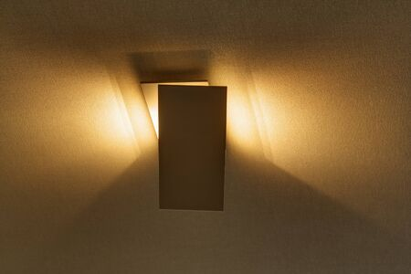 sconce: Modern sconce on the wall providing a beautiful soft light