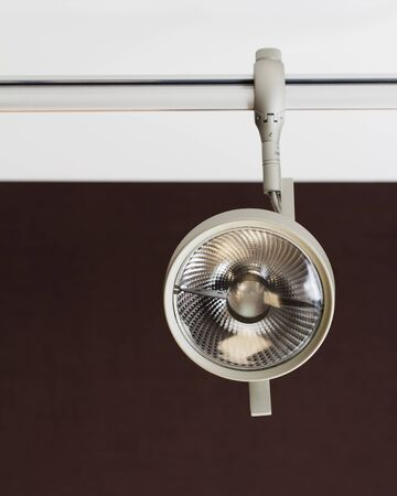 room accent: Closeup of a light of a track system under the ceiling Stock Photo