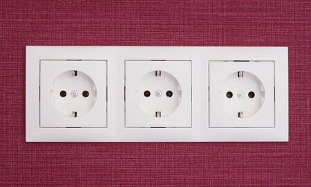 sockets: The white sockets in the wall