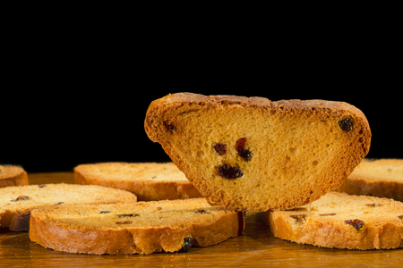 A group of sweet tasty rusks on wooden table Stock Photo