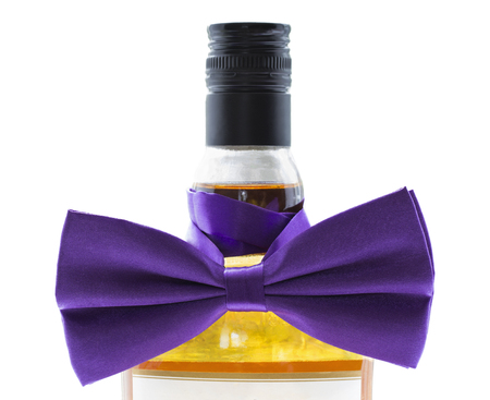 alcohol bottle: A bottle of strong alcohol tied with a violet bow