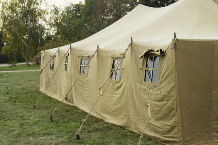 capacious: Very big military tent in the forest