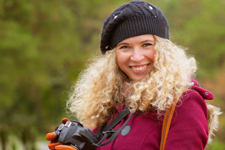 brown  eyed: A happy young blond girl with a digital camera