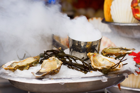 ostracean: Several oysters served with ice in a French restaurant in Paris
