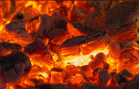 smoldering: Very hot charcoal burning in the touristic campfire Stock Photo