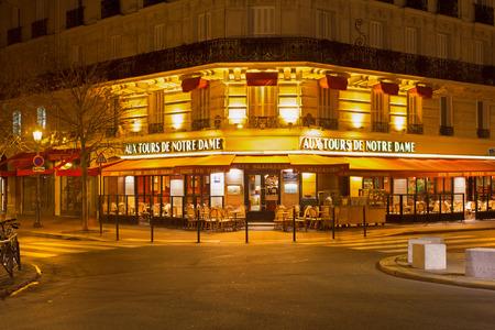 aux: FRANCE, PARIS - NOVEMBER 22, 2015: Aux Tours de Notre Dame restaurant near the Notre Dame De Paris Cathedral in the center of Paris in the evening. Editorial