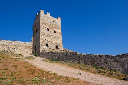genoese: Genoese fortress in Feodosia over dramatic cloudy blue sky, Crimea, Ukraine Stock Photo