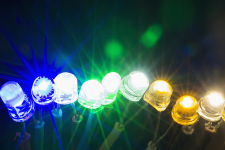 A row of colorful shining led lights Фото со стока