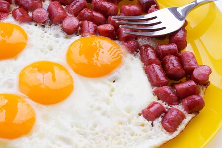high calorie: A plate of fresh breakfast made of roasted sausages and eggs
