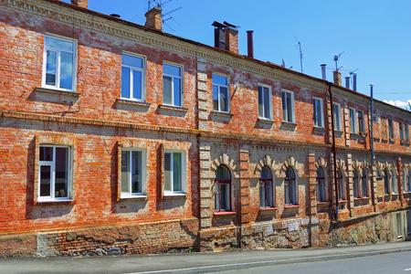 brick building: Old red brick building near the road in Vinnytsia, Ukraine