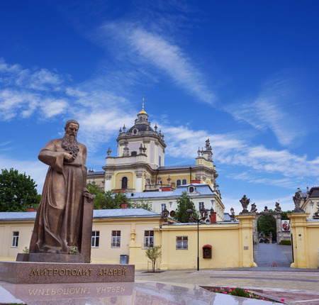 LVOV, UKRAINE - MAY 8, 2016:  Entrance to one of the most popular churches in Lviv - St. Georges Cathedral and a newly erected monument of metropolitan Andrey Sheptytsky