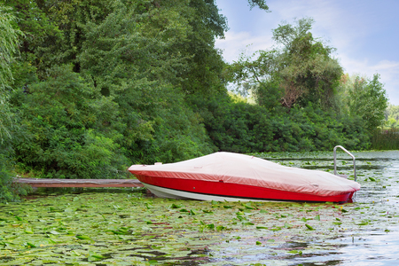 safekeeping: A motor boat protected from the sun and other elements