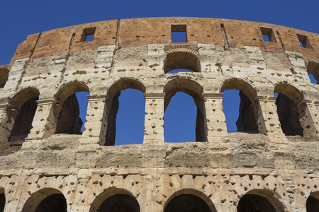 Coliseum fragment over beautiful blue sky, Rome, Italy