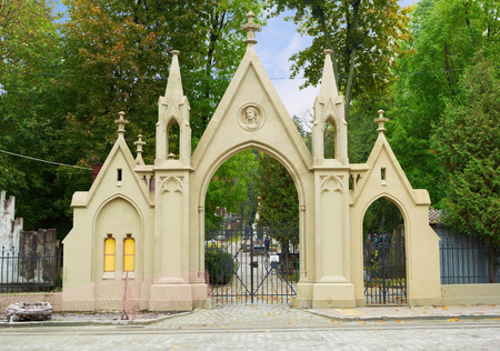 Entrance gate to Lychakiv cemetery in Lviv, Ukraine. Ancient Lychakiv Cemetery is a popular place among tourists. Stock Photo