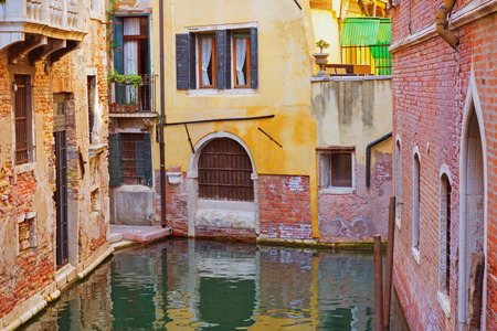 oldstyle: Interesting place in Venice, Italy. Venetian colorful old-style buildings surrounded by water.