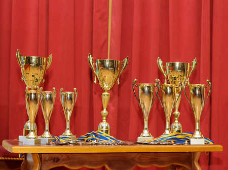 Many golden award cups waiting for their winners Stock Photo