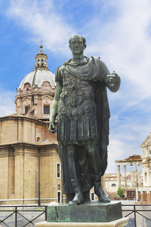 Bronze statue of emperor Julius Caesar over Temple of Venus Genetrix in Rome, Italy