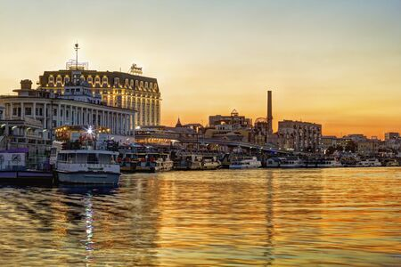 Kiev, Ukraine - August 9, 2016: View on the river bank of Poshtova Square and River Station at sunset. Tourists like to take a boat here and have an excursion. Editorial