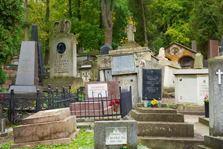 Lviv, Ukraine - 16 October, 2016: Lychakiv cemetery in Lviv, Ukraine. Multiple tombstones at one of the most popular places in Lviv.