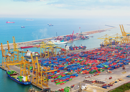 Barcelona, Spain - 26 March, 2017: View from Montjuic mountain on port of Barcelona. The port is full of cargo and cargo cranes. Editorial
