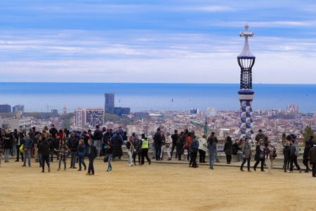 Barcelona, Spain - 1 April, 2017: Beautiful cloudy view of crowded Park Guell.