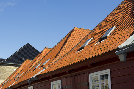 Red slate roofing of houses in Copenhagen, Denmark