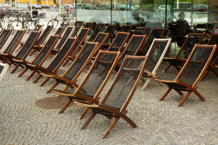 Wooden folding chairs by local cafe in Copenhagen, Denmark.