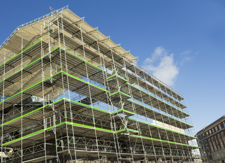 Building being reconstructed using scaffolding in Copenhagen, Denmark