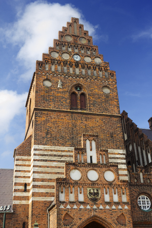 Town hall in Roskilde is 19th century building in Neo-gothic style. The Gothic tower, the only remain of the St. Lawrence church, built in the early 12th century and destroyed during the Reformation.