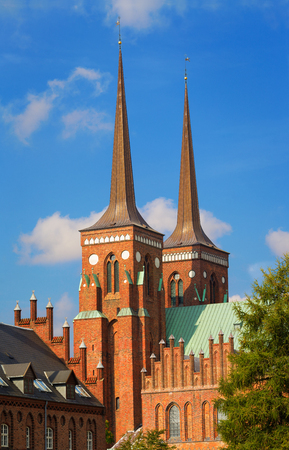 Famous Roskilde Cathedral with twin bell towers where the crypt of royal danish families are located, Denmark.